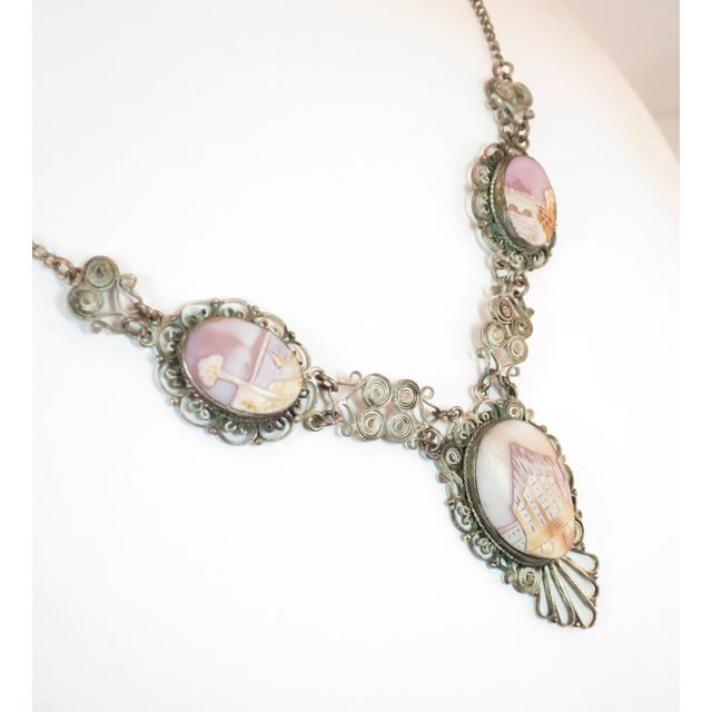 Offered here is a Victorian-style landscape shell cameo silvered filigree necklace from Italy in the 1950s. The central...