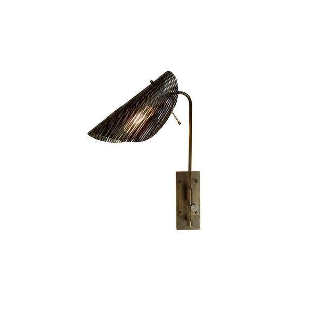 The TULLE wall lamp is an architectural piece that works well in both modern and transitional interiors. Shown here in our...