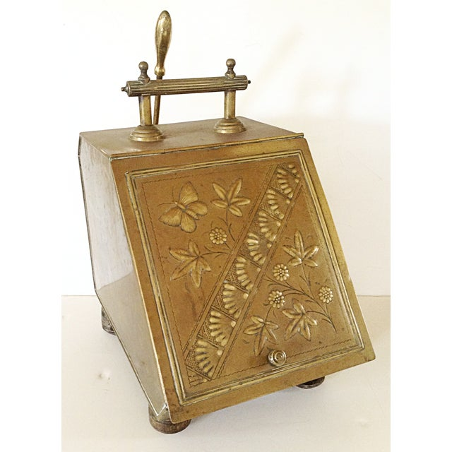 This brass shuttle is complete with liner and shovel. The lid is embossed with a lovely art nouveau floral design with...