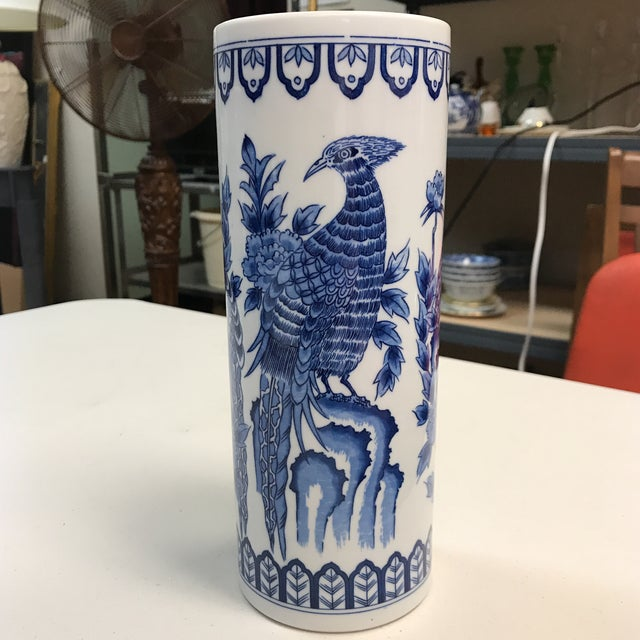 Gorgeous porcelain vase. Blue and white phoenix design with floral accents. This beautiful piece would be an eye-catching...