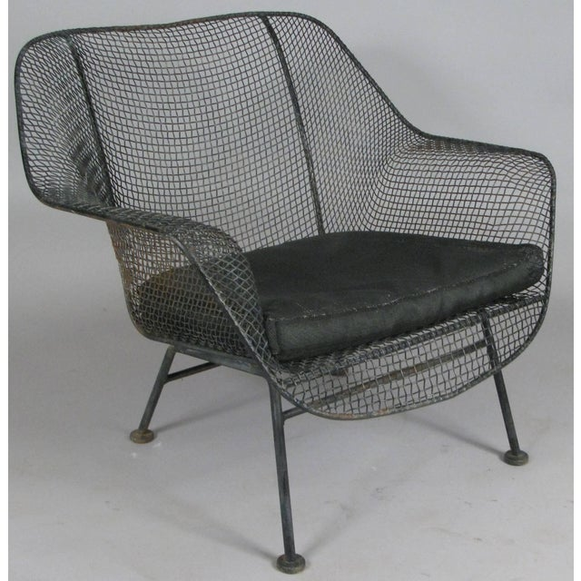 A pair of 1950s 'Sculptura' lounge chairs designed by Russell Woodard. Woodard's Sculptura collection was made with...