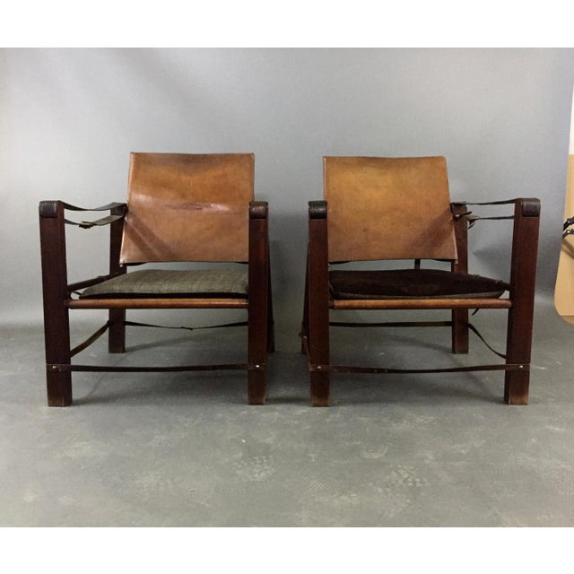 A mid-century American (likely) pair of Safari chairs (sold separately) constructed in the typical fashion with dowel and...