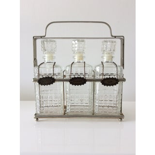 Vintage 3 Glass Decanters With Chrome Tantalus Preview