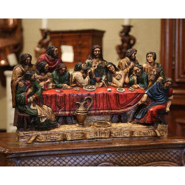 """The """"Last Supper"""" composition sculpture was created in Spain circa 1950; made of one piece of oak, the colorful piece..."""
