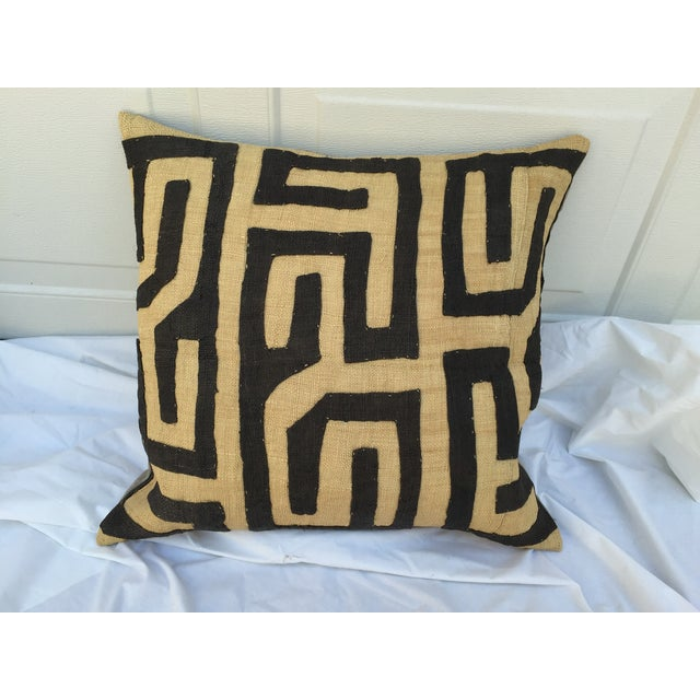 Custom pillow in a vintage African raffia Kuba hand-sewn textile purchased at a flea market in France. Backed in solid...