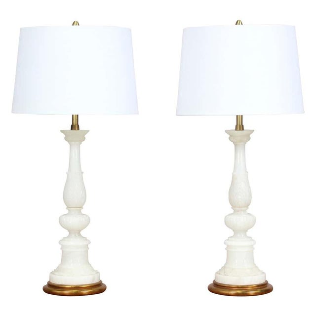 Elegant, Italian 1940s carved alabaster lamps mounted on gilt wood bases in the neoclassical style by the Marbro Lamp...