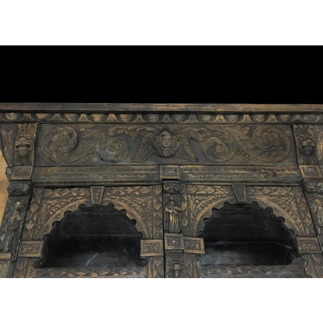 This exquisite 19th Century English Renaissance Bookcase provides display and storage in Old World style! Hand-carved all...
