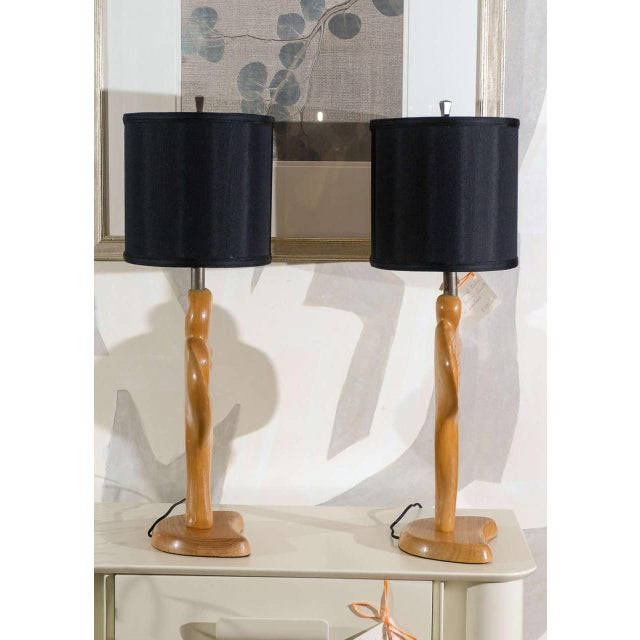 A rare, gorgeous pair of carved male and female lamps by Yasha Heifetz, circa 1950. Fabulous dramatic form. Excellent...