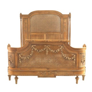 French Louis XVI Style Carved Walnut and Cane Bed For Sale