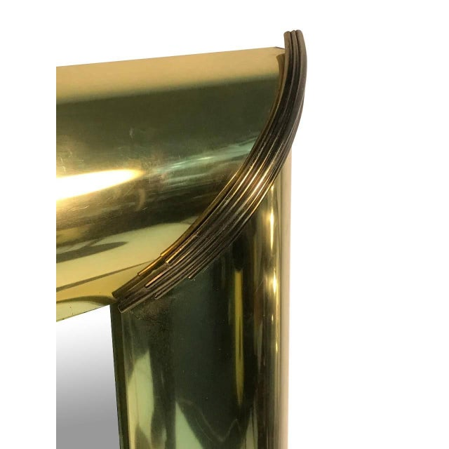 """Mirror with brass trim and bold moldings details of reeded edges Mastercraft quality, circa 1970 Brass frame 6"""" wide."""