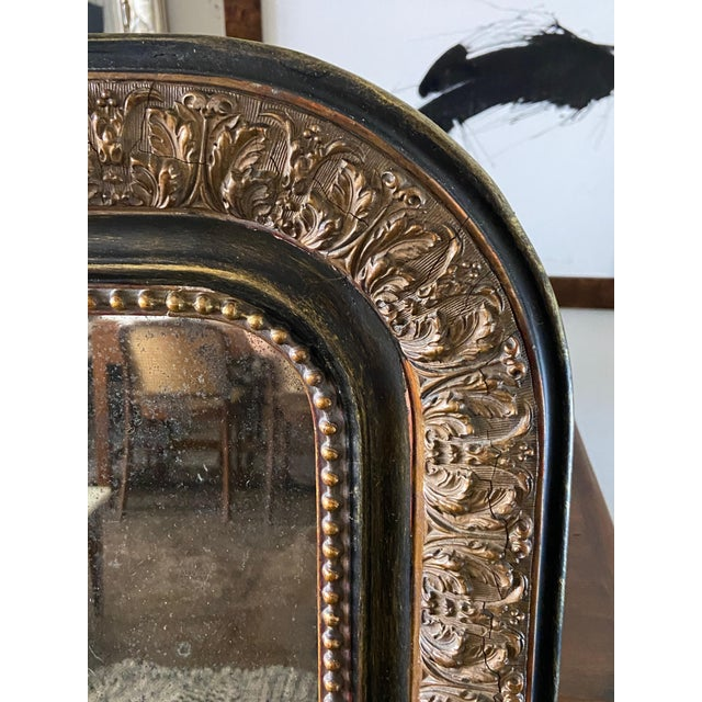 A beautiful French,Turn of the 20th Century,Louis mirror, sourced from the northern part of France. Guilded details on an...