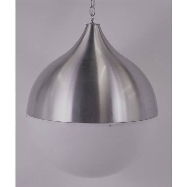 Large Danish globe chandelier with a brushed aluminum Hershey's Kiss shaped dome top over a white acrylic dome bottom....
