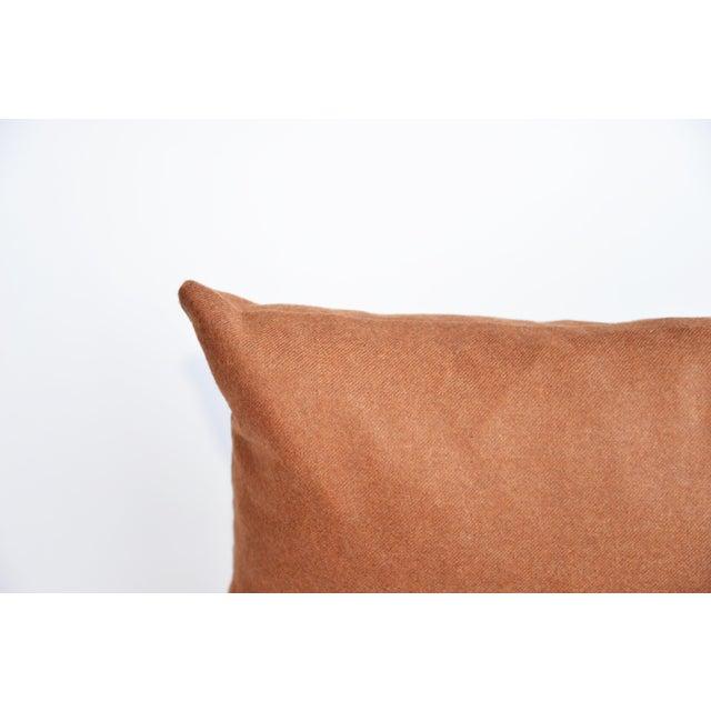 Soft wool with hidden zipper.