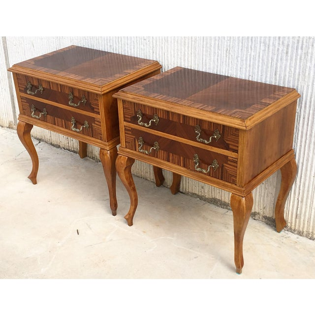 20th century pair of Mid-Century Modern nighstands with two drawers.