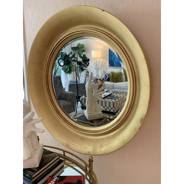 This gold round mirror is truly unique that is sure to bring a fresh look to any wall space. The gold frame adds a touch...