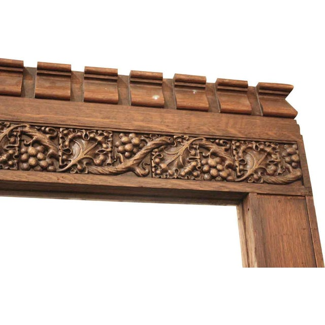 Large tiger oak floor mirror or over mantel mirror. This mirror frame has a dark stain with an ornate grape vine carving...