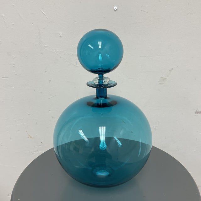 Design Plus Gallery presents a Handblown Steel Blue Low Round Petite Decanter by Joe Cariati. Quintessentially Modern in...