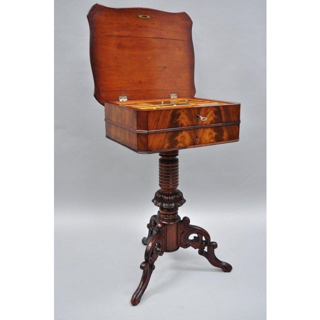 Item: Antique Victorian Sewing Stand Side Table in Crotch Mahogany & Walnut Details: Crotch mahogany banded top, ornately...