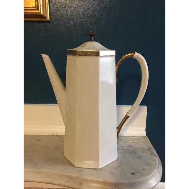 This coffee pot is quite striking. It has eight sides and a metal finial on the lid. It is also very large and would be...