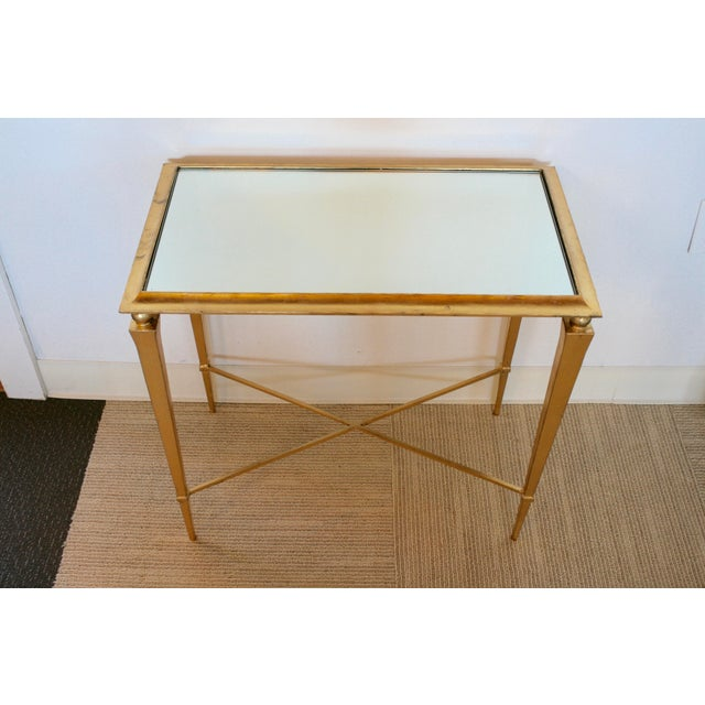 The classic shape of its antique gold legs paired with a beautiful mirrored top makes this side table a timeless,...