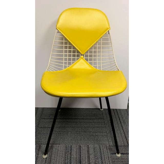 Vintage Eames Bikini Chair in vintage yellow by Herman Miller. Amazing original condition with button. Very clean with no...