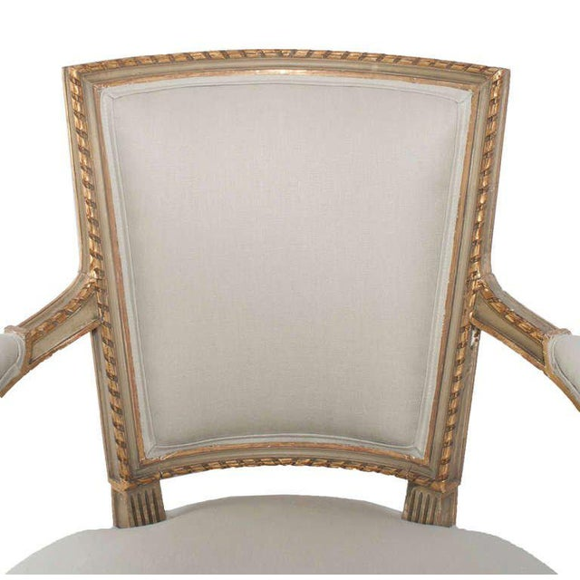 A set of four painted and gilt napoleon III fauteuils, seat and back are reconditioned and covered with new cotton and...
