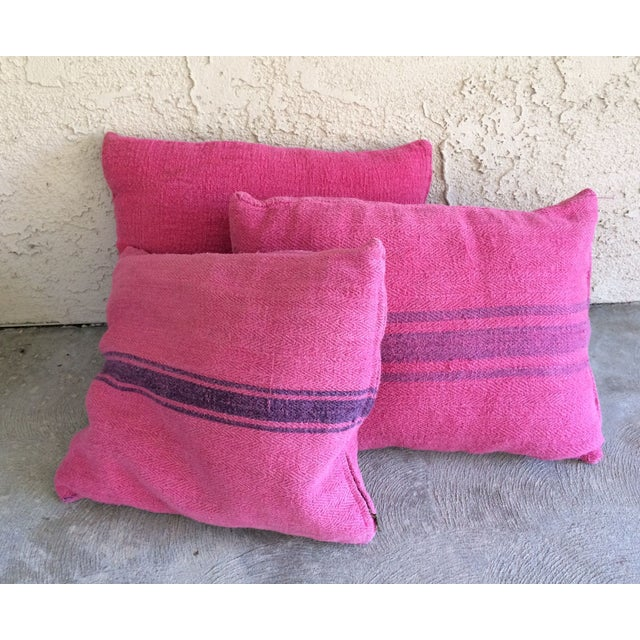 Dyed pink and turned into pillows, these grain sacks are anything but ordinary. The bright pinks and purples are ideal for...