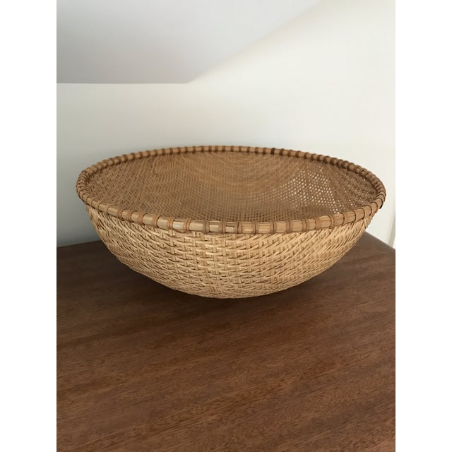Oversized winnowing basket would be lovely on a coffee or dining table.