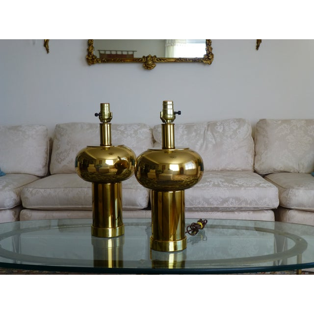 """Pair of mid-century modernist brass ball lamps circa 1970's. They measure 18"""" to the top of sockets, 9"""" at widest and 4.5""""..."""