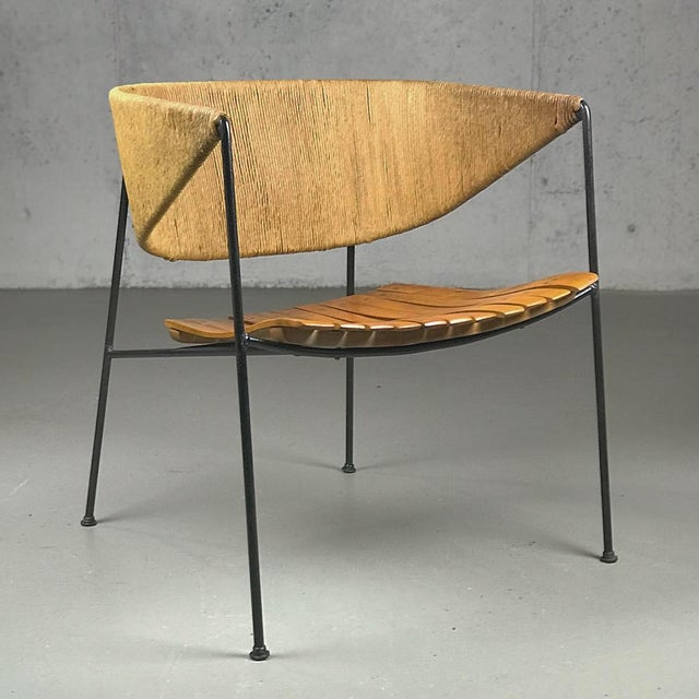 An exceptional example of museum-quality American Modern design; 1950's lounge chair by Arthur Umanoff, manufactured by...