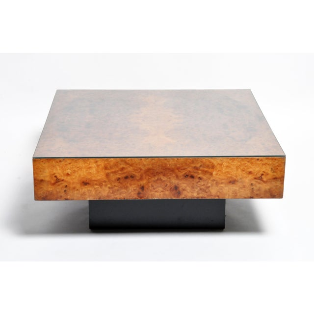 This burl wood table is from France and made from burl wood and glass. The table features two drawers and a beautifully...