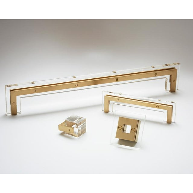 Our brass and acrylic handle acts as a piece of jewelry for your home. It allows for a shallow profile while maintaining...