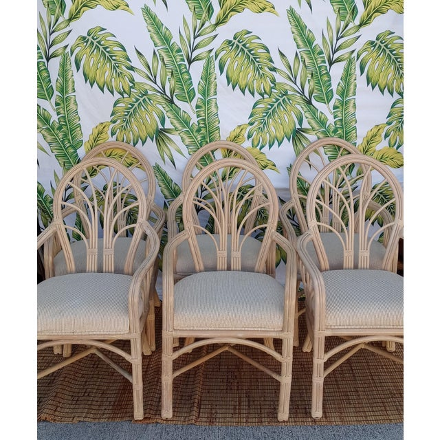 Set of 6 vintage rattan dining room chairs. The chairs have a nice design on the backs and sides. The seat cushions are...