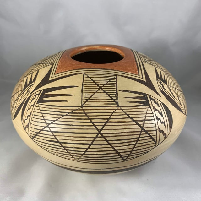Expertly made and exquisitely painted migration seed jar by Hopi artist Elva Nampeyo (Hopi, 1926-1985). Born in the Corn...