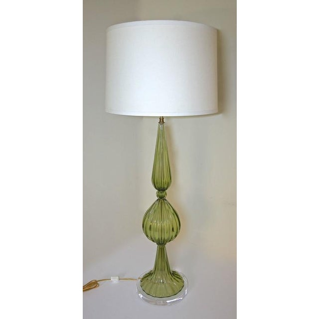 Monumental absinthe green Murano handblown glass table lamp by Barbini. New custom acrylic base with new double brass...