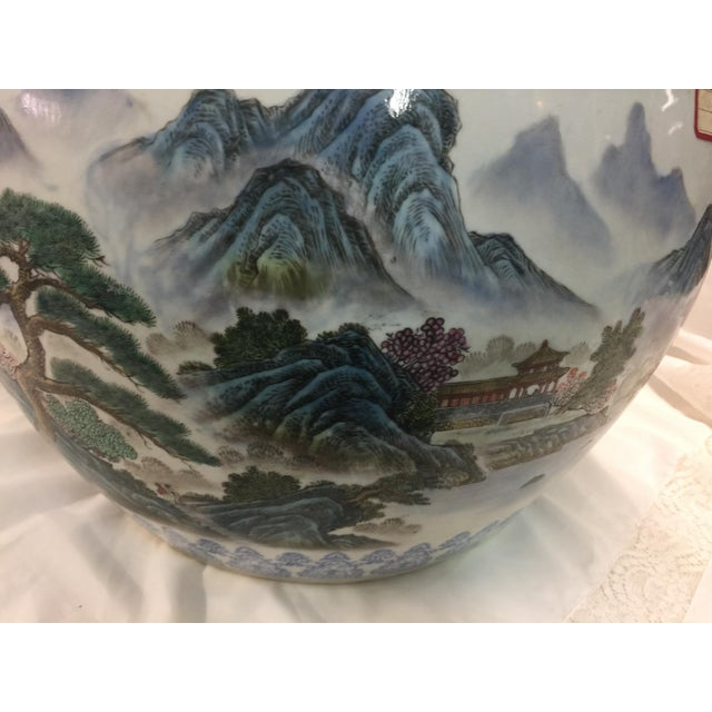Chinese Handpainted Fishbowl or planter. Lovely scene painted around all sides, temples, mountains , rivers, signed with...