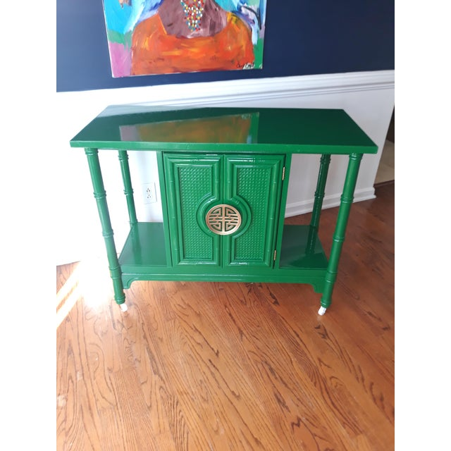 Make a statement with this vintage ultra glossy green lacquer rolling bar cart . The bar cart features plenty of open...