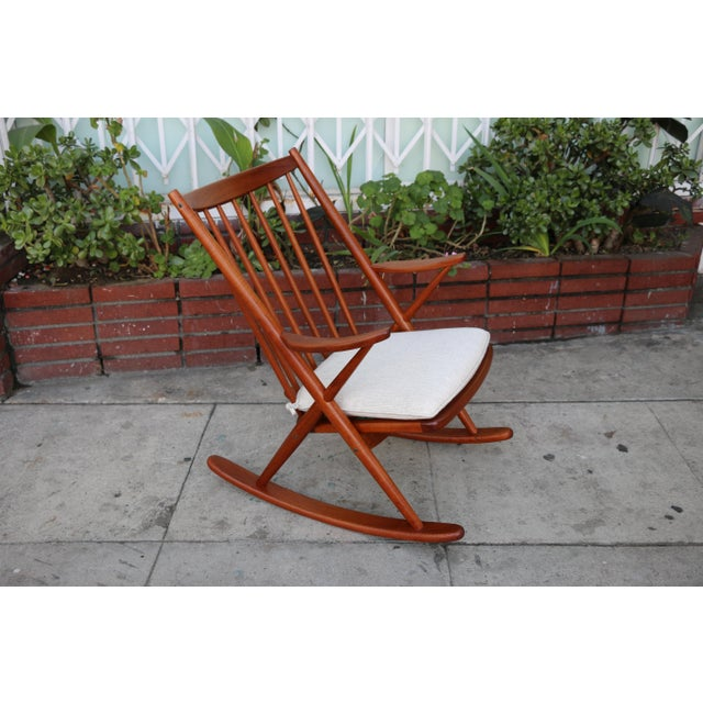Just reupholstered and Refinished Teak Rocking chair in excellent condition. No damages or missing parts. Rocks perfectly....