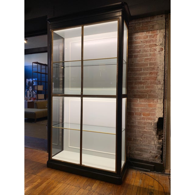 A well-designed piece that is quite sizable but the tempered glass components serve to reduce the actual size in an...