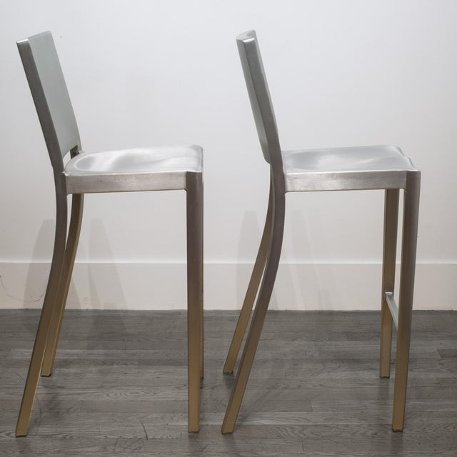 ABOUT This is an original set of four brushed aluminum Emeco Hudson counter stools designed by Philippe Stark. The stools...