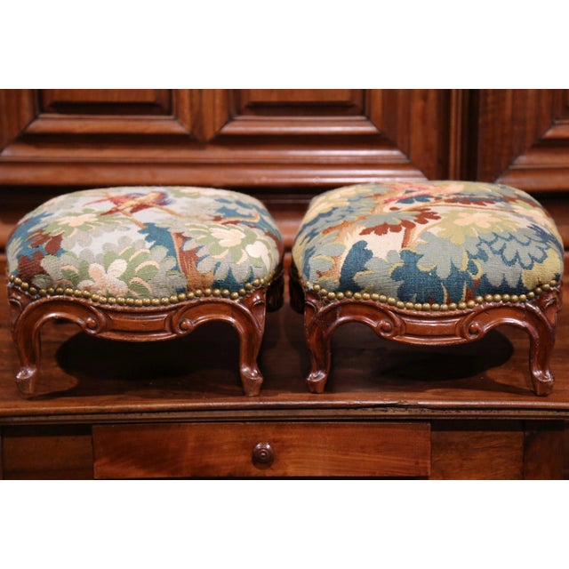 Incorporate neoclassical beauty into your home with this exquisite pair of colorful Louis XV carved footstools from Lyon,...