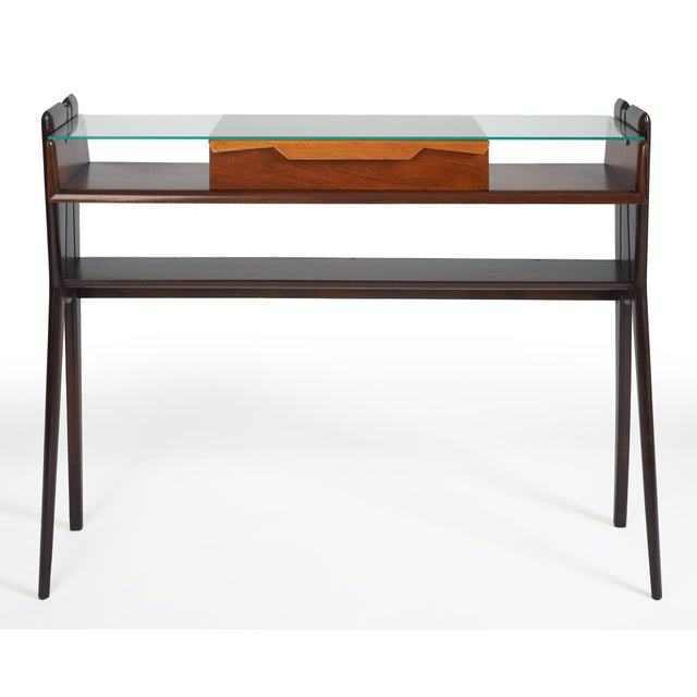 Ico Parisi (1916–1996), attributed to A lissome, organic three-shelf console table in rosewood, with playful, geometric...