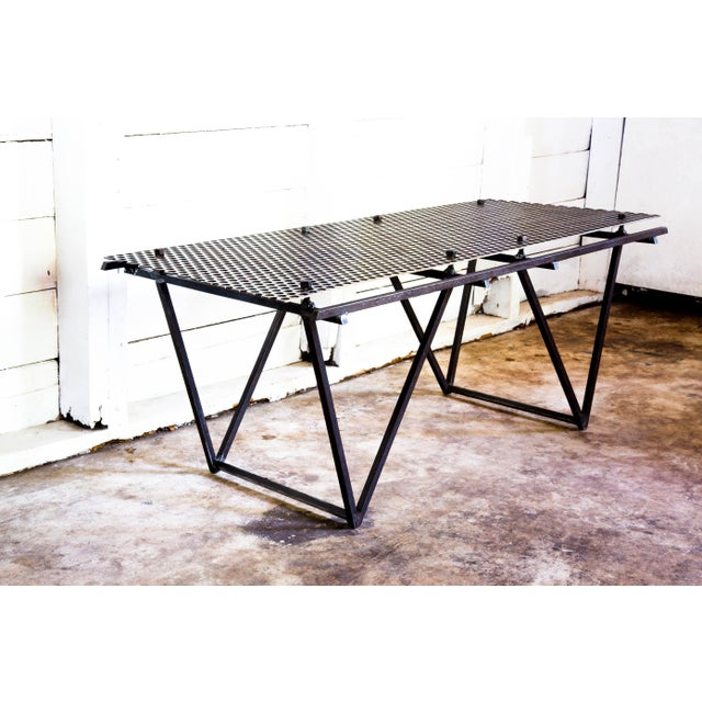 Created by hand in San Antonio, TX. Designed of perforated carbon that 'floats' above a double-triangle base welded of...