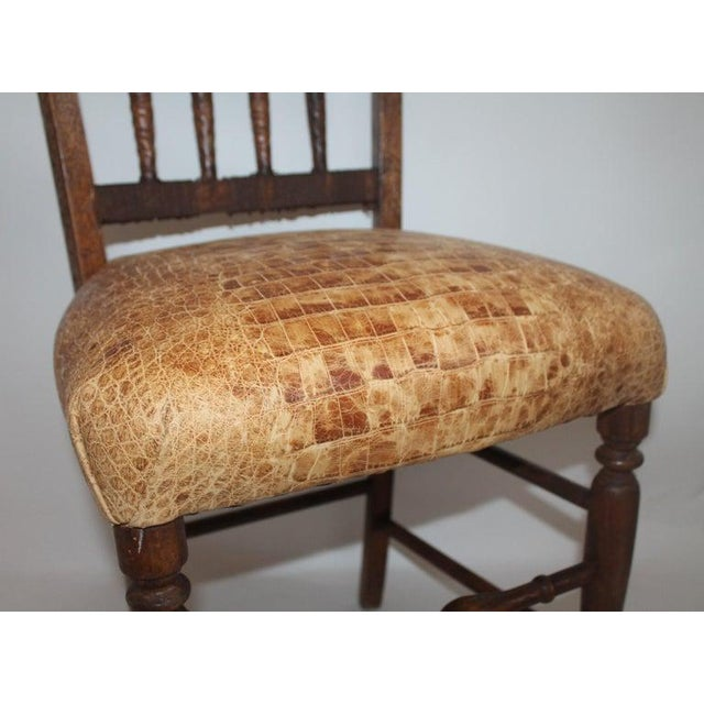 This amazing handmade English chess chair is hand carved. The chair seat is hand webbing made from hemp. The hand carved...