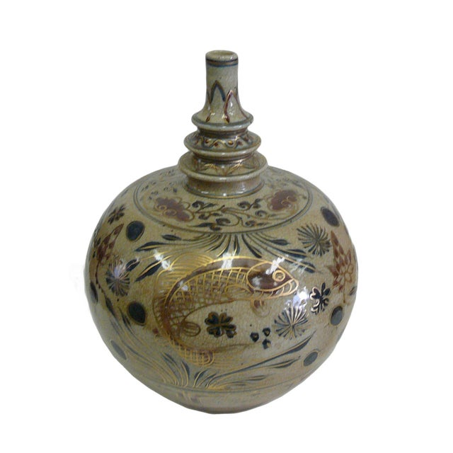 This is a handmade porcelain vase in a beige color crackle pattern. The surface features a fish pattern in brown, gold &...