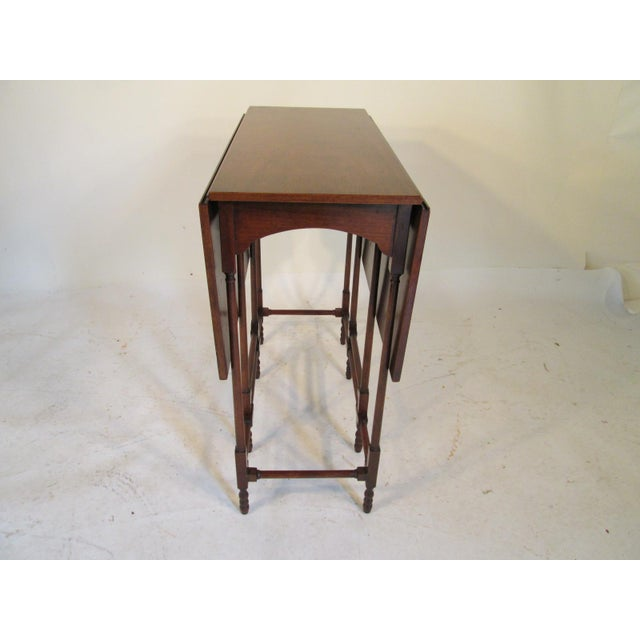 This is a wonderful end table made of solid mahogany made by Baker furniture here in the USA. This gate legged table is...
