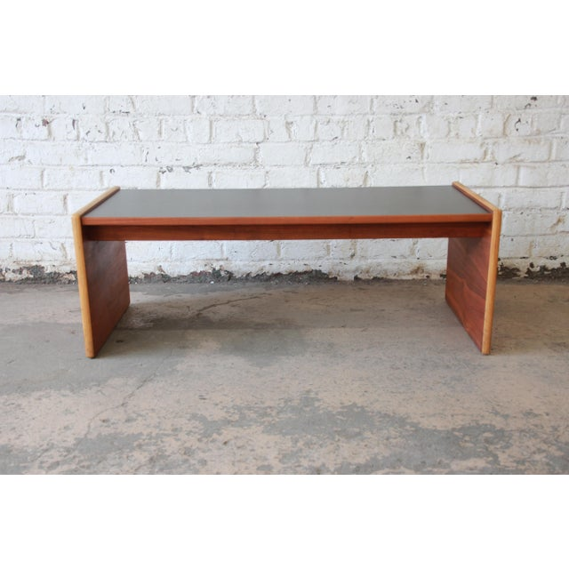 Offering a very nice and stylish mid-century modern coffee table or bench by Jens Risom. The bench features a beautiful...