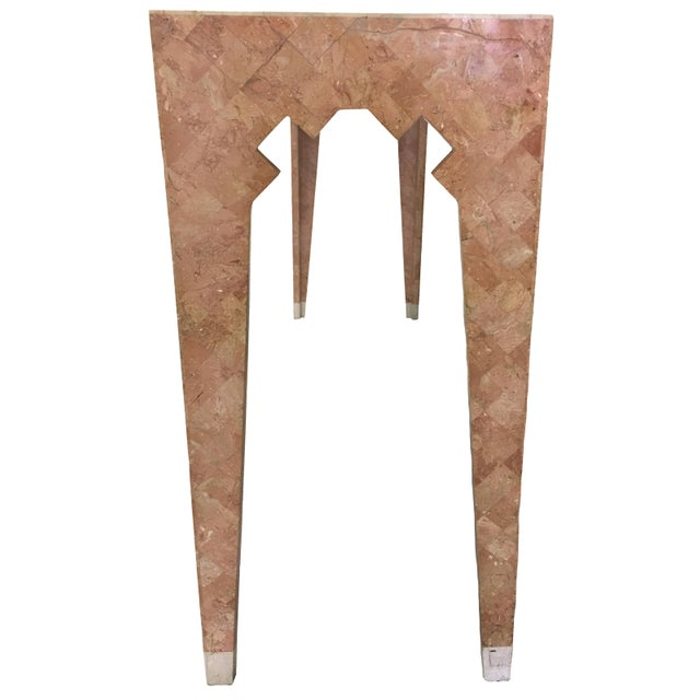 Pink tessellated stone console table by Maitland Smith. Beige stone feet and geometric detailing. No makers mark.