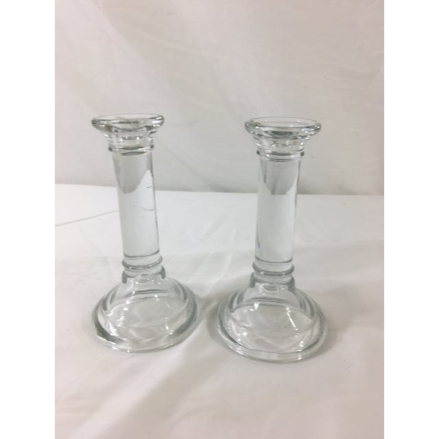 This pair of glass column candlesticks date to the 1940's. They are wonderfully simple and in excellent condition.