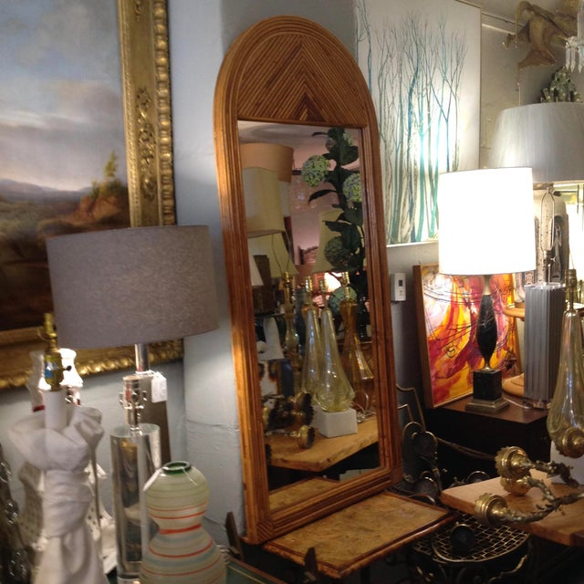 The mirror is tall and stately , inspired by Gabriella Crespi
